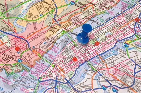 Push Pin Manhattan stock photo, A push pin in a map of Manhattan. by Robert Byron
