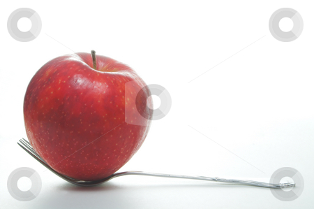 Serving of Fruit stock photo, An fork full of apple. A serving of fruit. by Robert Byron