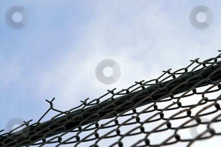Chain Link Fence stock photo, A chain link fence for keeping people out or keeping people in. by Robert Byron