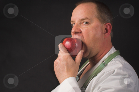 An Apple a Day stock photo, An apple a day keeps the doctor away. by Robert Byron