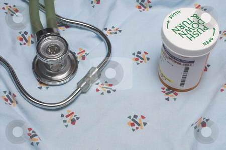 Medical Supplies stock photo, A medical gown, stethoscope and bottle of pills. by Robert Byron