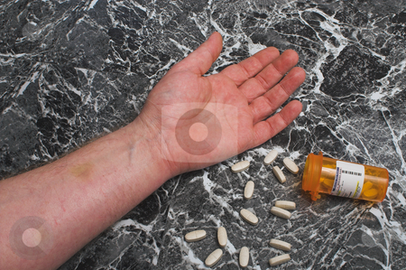 Overdose stock photo, A person has overdosed on prescription medication. by Robert Byron