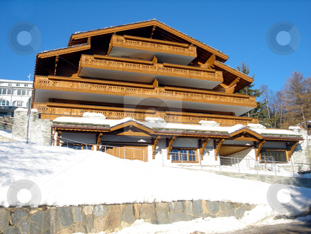 Ski Chalet in winter stock photo, Exterior architecture of Swiss Ski chalety in winter snow. by Martin Crowdy