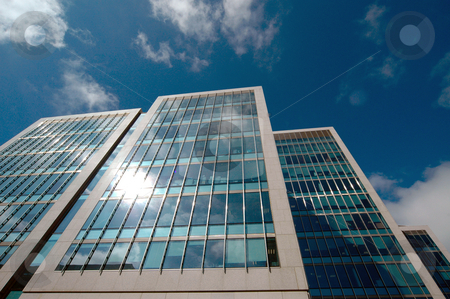 Office buildings stock photo, Exterior architecture of modern office buildings. by Martin Crowdy