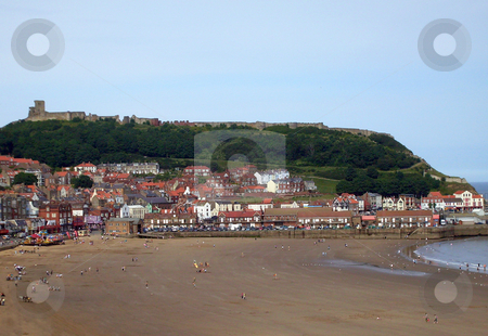 Seaside scenery England stock photo, Castle and beach in Scarborough, England. by Martin Crowdy