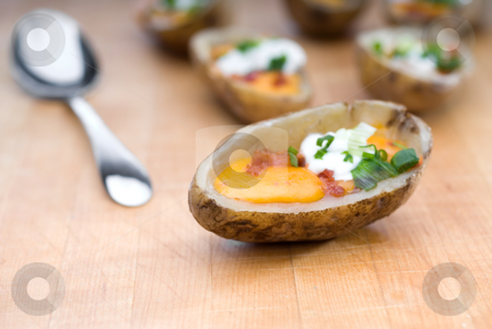Shallow focus potato skins stock photo, Shallow focus potato skins by Vince Clements