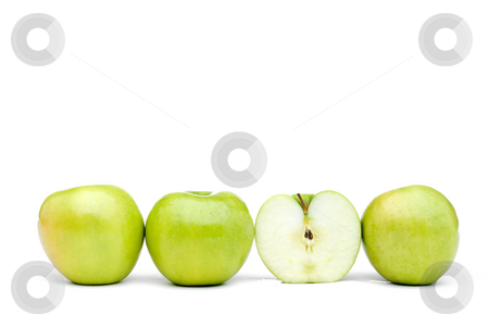 Fresh green apples iwth one sliced stock photo, Green apples line up on a white background with one sliced by Vince Clements