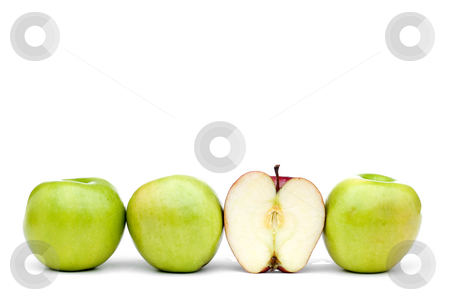 Green apples with an individual eaten red apple stock photo, Green apples lined up on a white background with a single different eaten red apple by Vince Clements