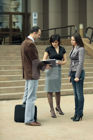 Talking with a client  stock photo, Young business team talking outdoors at a staff meeting or with a client by Claudia Veja