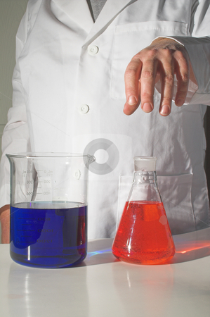 Scientist stock photo, A scientist working with chemicals in a laboratory. by Robert Byron