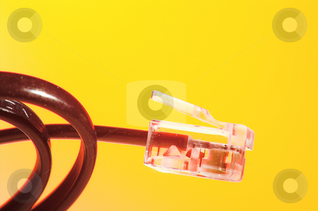 Telephone Cord stock photo, A telephone communications cord that plugs into a wall jack. by Robert Byron