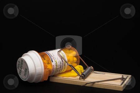Prescription Medication in a Mouse Trap stock photo, Prescription medication in a Mouse Trap. Information on label is fictitious and was manufactured by the photographer. by Robert Byron