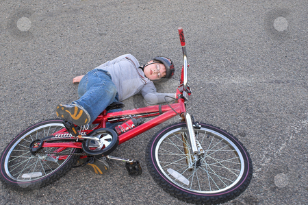 Bike Wreck stock photo, A young boy who crashed his bike. by Robert Byron