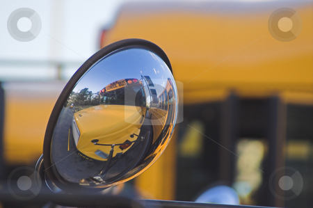 School Bus stock photo, The reflection of a school bus in a bus mirror. by Robert Byron