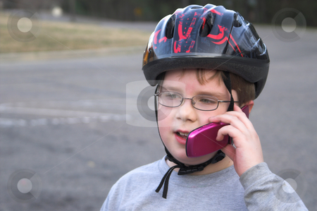 Boy Talking on a Cell Phone stock photo, A young boy talking on a cell phone. by Robert Byron