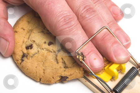 Diet Plan stock photo, A hand caught in a mousetrap. Dieting concept. by Robert Byron