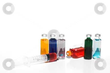 Syringe and Medication stock photo, Prescription medicine vials and a syringe. by Robert Byron