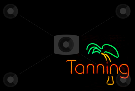 Neon Tanning Sign stock photo, A colorful neon sign advertising a tanning booth. by Robert Byron