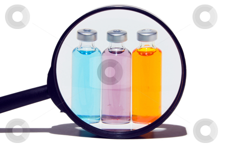 Medicine Vials stock photo, Prescription medicine vials under a magnifying glass by Robert Byron