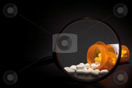 Prescription Medication Magnified stock photo, Prescription pills in a plastic medicine bottle. by Robert Byron