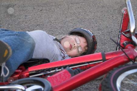 Bicycle Wreck stock photo, A young boy who has crashed his bicycle. by Robert Byron