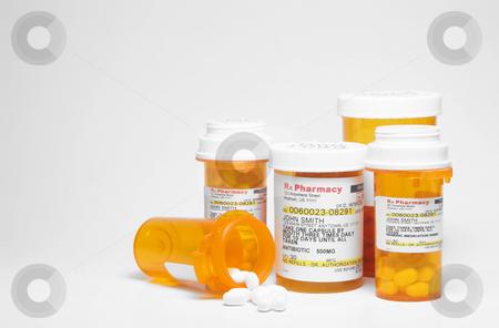 Prescription Medication stock photo, Prescription pills in plastic medicine bottles. by Robert Byron
