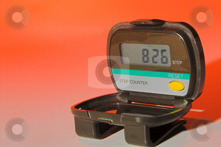 Pedometer stock photo, A pedometer used to count steps while walking. Fitness concept. by Robert Byron