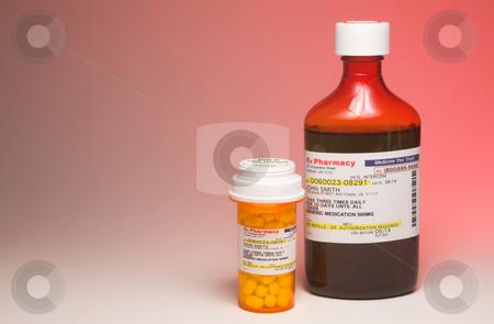 Prescription Medication stock photo, A bottle of liquid medication and a bottle of prescription pills. by Robert Byron