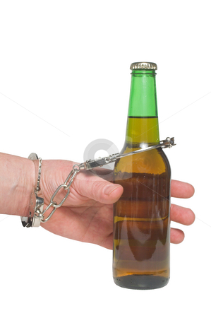 Alcoholic stock photo, An alcoholic chained to his beer bottle. by Robert Byron