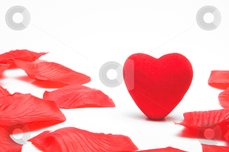 Lone Heart stock photo, A lone heart in the middle of artificial rose petals. by Robert Byron
