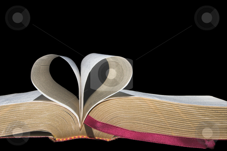 Love Book stock photo, Pages of a book folded in to a heart shape. by Robert Byron