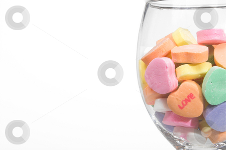 Conversation Hearts in a Wine Glass stock photo, Conversation hearts in a wine glass. Concept of love. by Robert Byron