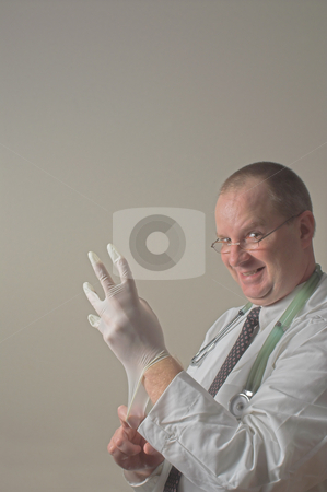 Proctologist stock photo, A proctologist preparing for a patient examination. by Robert Byron