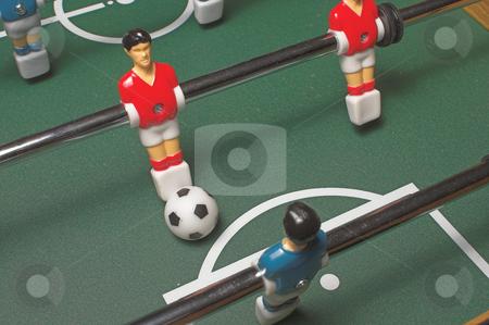 Foosball Game stock photo, A miniature tabletop foosball arcade type game. by Robert Byron