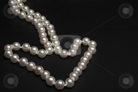 Pearl Arrow stock photo, A string of pearls arranged in the shape of an arrow. by Robert Byron