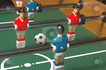 Foosball Game stock photo, A miniature tabletop foosball arcade type game. by Robert Byron