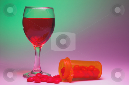 Drugs and Alcohol stock photo, A glass of wine and a bottle of pills. by Robert Byron