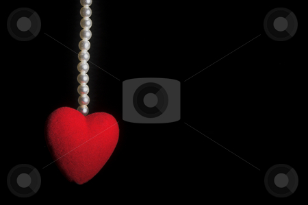 Heart with Pearls stock photo, A string of pearls and a red heart. by Robert Byron