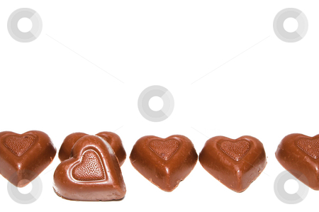 Heart Chocolates stock photo, A line of delicious heart shaped milk chocolates. by Robert Byron
