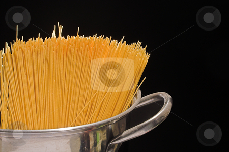 Spaghetti stock photo, Raw spaghetti in a stock pot ready to be cooked. by Robert Byron