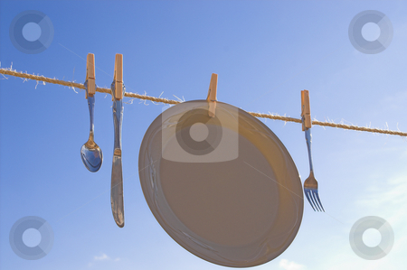 Drying Dishes stock photo, Dishes hung out to dry on a clothesline. by Robert Byron