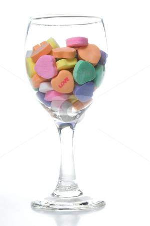 Conversation Hearts stock photo, A wine glass full of valentine conversation hearts. by Robert Byron