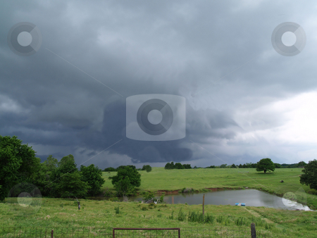 A storms brewing stock photo, Out on the farm overlooking a pond with an approaching storm by Michelle Bergkamp