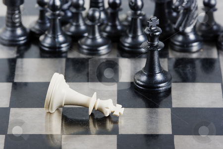 Chess stock photo, Some pieces of a chess game in a check mate by Ivan Montero