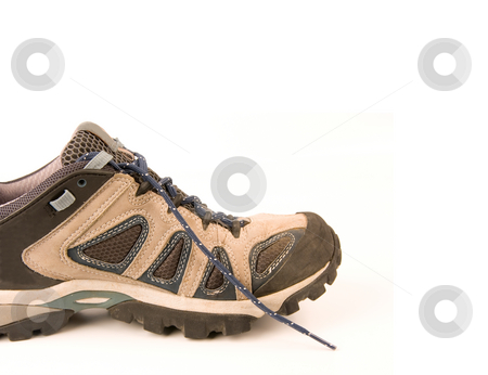 Clothes hiking boots or shoes isolated on a withe background made of leather and waterproof and brea stock photo, Clothes hiking boots or shoes isolated on a withe background made of leather and waterproof and breathable membrane by Ivan Montero