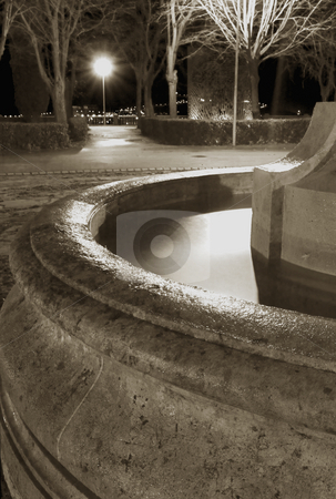 Fountain stock photo, Abstract image of a fountain at night by Ivan Montero