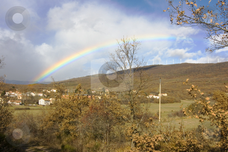 Rainbow stock photo, Image of a colorful rainbow in the sky by Ivan Montero