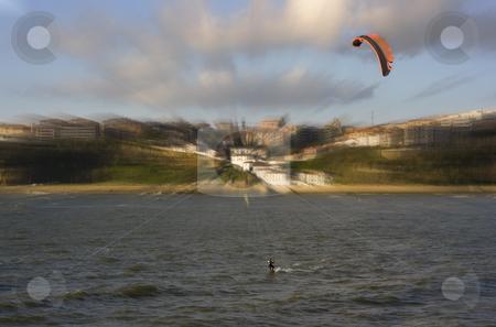 Beach sport water kite surf. a man practicing kite surfing in the beach stock photo, Beach sport water kite surf. a man practicing kite surfing in the beach by Ivan Montero