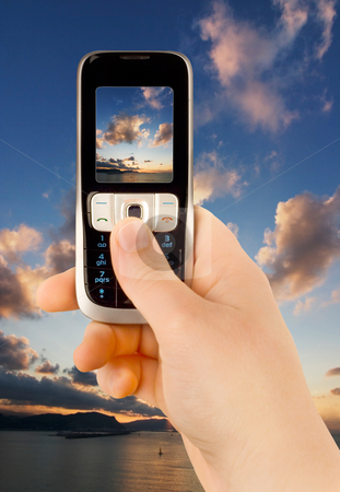 Technology communication phone stock photo, A technology cellular phone holding in a human hand by Ivan Montero