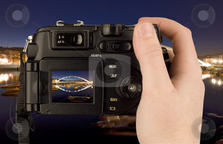 Hand snapping a Digital Camera photo stock photo, Digital Camera photo in a hand isolated on withe background. lcd screen and background can be easily edited by Ivan Montero